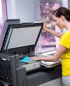 Young Woman Using Copier Machine